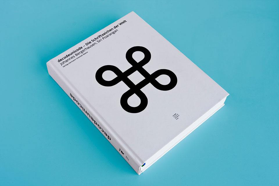 the decodeunicode book lying on a blue background
